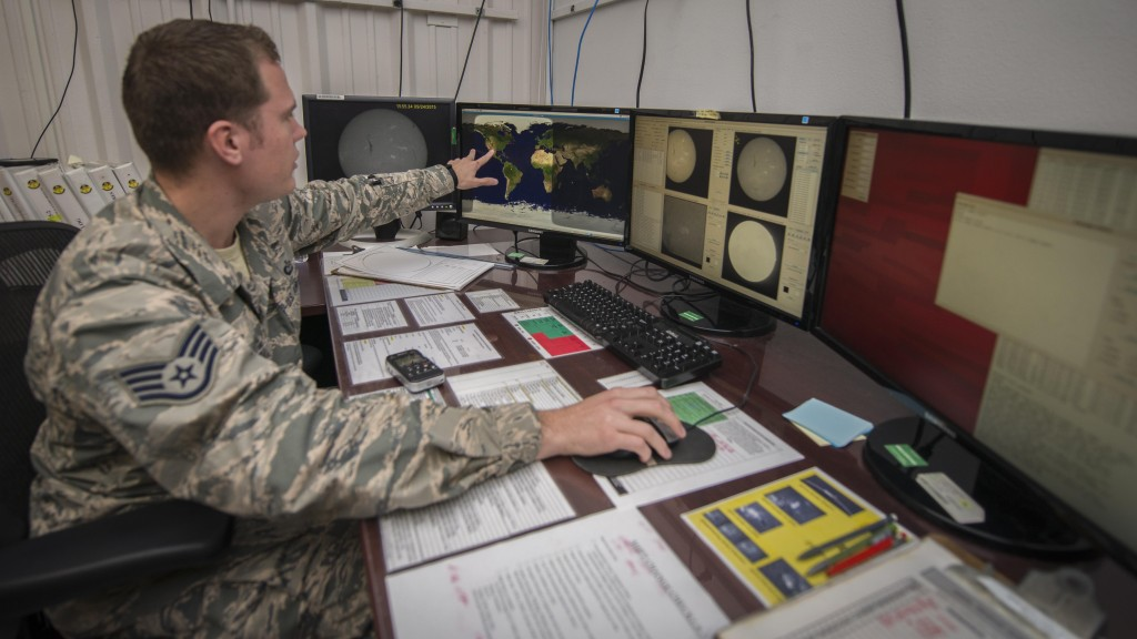 Staff Sgt. Erin O'Connell, a solar analyst with Detachment 2, 2nd Weather Squadron, monitors multiple live readings from the sun at the Holloman Solar Observatory on Holloman Air Force Base, N.M., Sept. 24, 2015. O'Connell was looking for any kind of solar activity that might affect Earth. The solar observatory works jointly with civilian and Defense Department customers who utilize the information in different ways. Image Credit: U.S. Air Force photo/Senior Airman Aaron Montoya