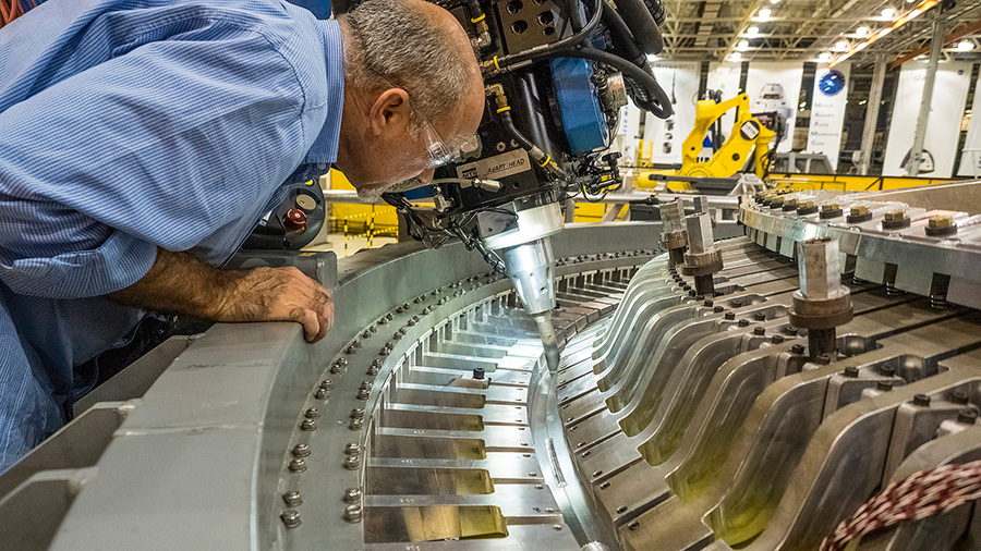 At Michoud Assembly Facility, technicians welded together Orion's barrel and aft bulkhead inside a tooling structure. Image Credit: NASA