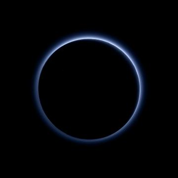 Pluto's haze layer shows its blue color in this picture taken by the New Horizons Ralph/Multispectral Visible Imaging Camera (MVIC). The high-altitude haze is thought to be similar in nature to that seen at Saturn's moon Titan. The source of both hazes likely involves sunlight-initiated chemical reactions of nitrogen and methane, leading to relatively small, soot-like particles (called tholins) that grow as they settle toward the surface. This image was generated by software that combines information from blue, red and near-infrared images to replicate the color a human eye would perceive as closely as possible. Image Credit: NASA/JHUAPL/SwRI