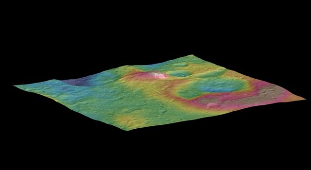 This view, made using images taken by NASA's Dawn spacecraft, features a tall conical mountain on Ceres. Elevations span a range of about 5 miles (8 kilometers) from the lowest places in this region to the highest terrains. Blue represents the lowest elevation, and brown is the highest. The white streaks seen running down the side of the mountain are especially bright parts of the surface. Image Credit: NASA/JPL-Caltech/UCLA/MPS/DLR/IDA/PSI