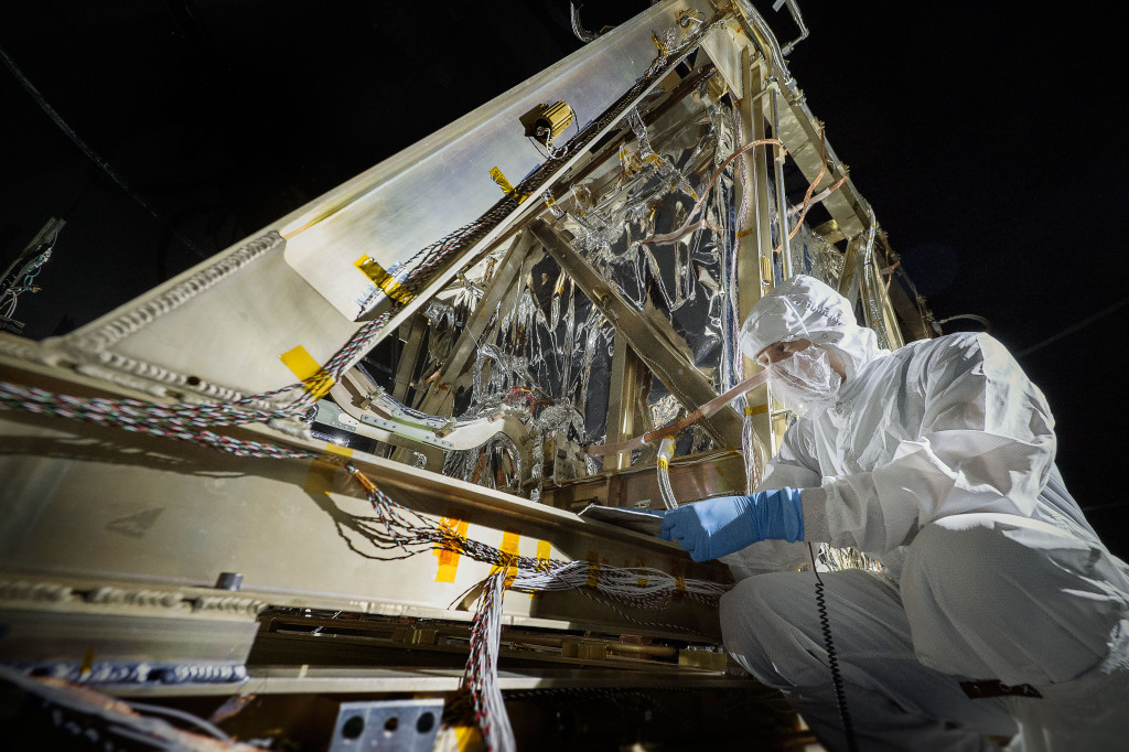 Contamination Control Engineer Alan Abeel conducts final inspections and places contamination foils before the start of the test. Image Credit: NASA/Chris Gunn