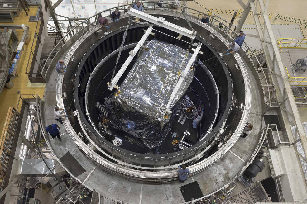 This rare overhead view of the thermal vacuum chamber at NASA's Goddard Space Flight Center in Greenbelt, Maryland shows engineers readying the Integrate Science Instrument Module (ISIM) that was just lowered into the chamber for its final cryogenic test at Goddard. Image Credit: NASA/Chris Gunn