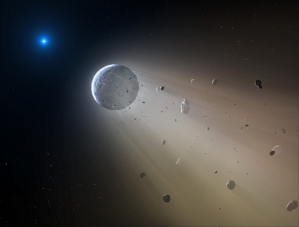 In this artist's conception, a tiny rocky object vaporizes as it orbits a white dwarf star. Astronomers have detected the first planetary object transiting a white dwarf using data from the K2 mission. Slowly the object will disintegrate, leaving a dusting of metals on the surface of the star. Image Credit: CfA/Mark A. Garlick