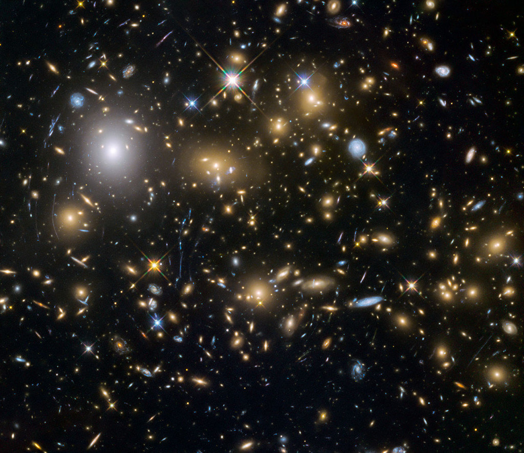 This image from the NASA/ESA Hubble Space Telescope shows the galaxy cluster MACSJ0717.5+3745. This is one of six being studied by the Hubble Frontier Fields programme, which together have produced the deepest images of gravitational lensing ever made. Image Credit: NASA, ESA and the HST Frontier Fields team (STScI)