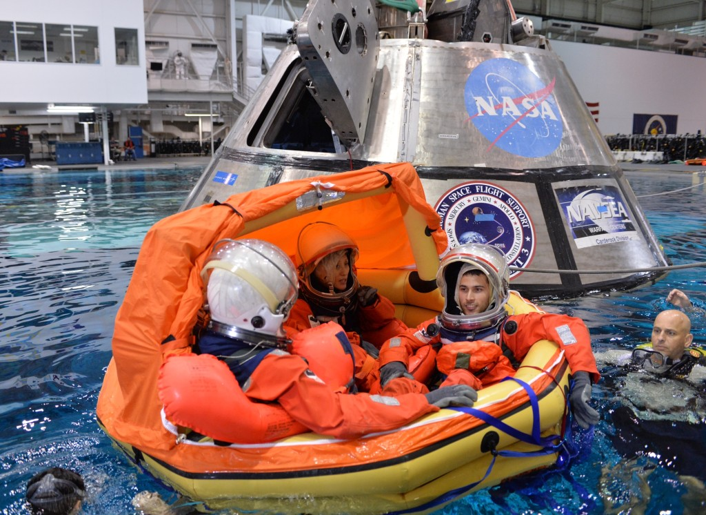 Engineers participate in testing to evaluate procedures to recover crews from Orion after splashdown in the Pacific Ocean on future missions. The training took place at the Neutral Buoyancy Laboratory at NASA's Johnson Space Center in Houston. Image Credits: NASA