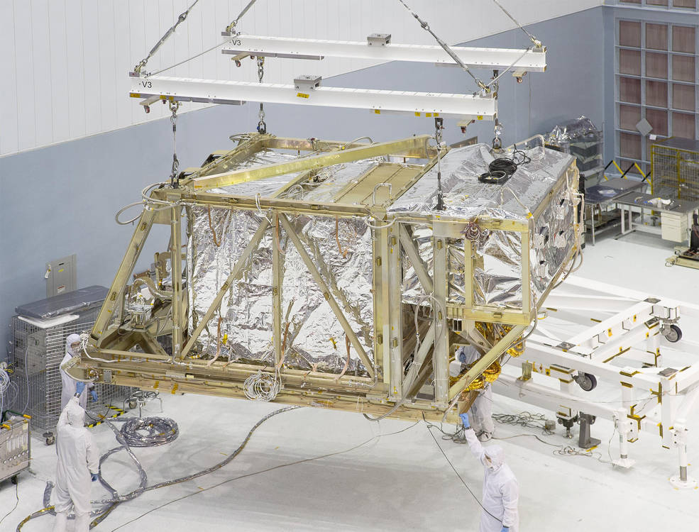 The James Webb Space Telescope team lifts the Integrated Science Instrument Module (ISIM) structure by crane as it leaves the Goddard clean room for the thermal vacuum chamber. Image Credit: NASA/Chris Gunn