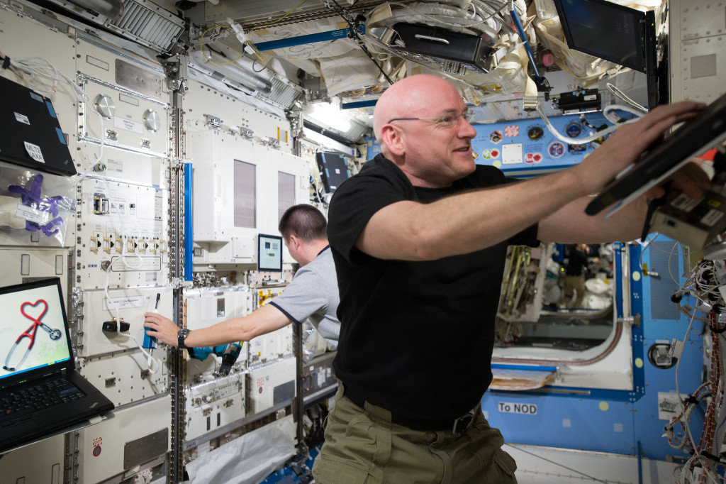 NASA Astronaut Scott Kelly works inside the U.S. Destiny Laboratory. Destiny is the primary research laboratory for U.S. payloads, supporting a wide range of experiments and studies contributing to health, safety and quality of life for people all over the world. Image Credit: NASA
