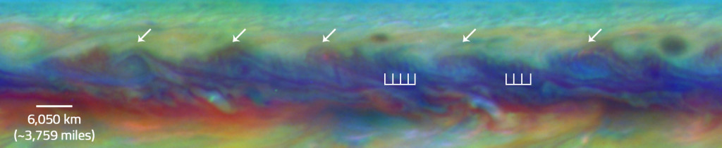 In Jupiter's North Equatorial Belt, scientists spotted a rare wave that had been seen there only once before. It is similar to a wave that sometimes occurs in Earth's atmosphere when cyclones are forming. This false-color close-up of Jupiter shows cyclones (arrows) and the wave (vertical lines). Image Credit: NASA/ESA/Goddard/UCBerkeley/JPL-Caltech/STScI