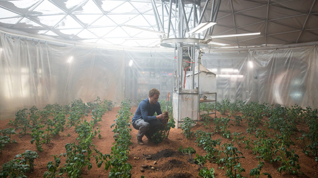 "n a scene from ""The Martian,"" astronaut Mark Watney employs some ingenious methods to plant crops on Mars. Image Credit: Peter Mountain"