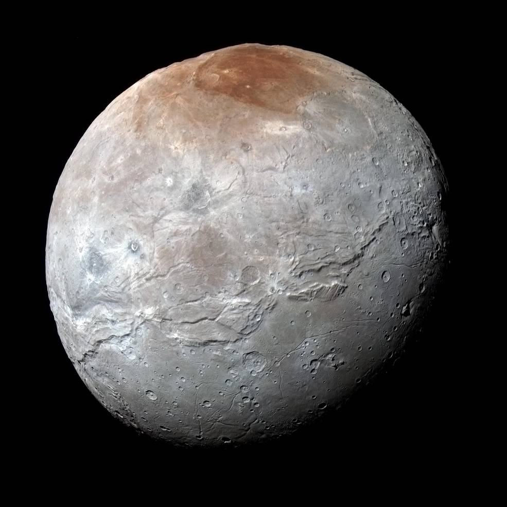 Charon in Enhanced Color NASA's New Horizons captured this high-resolution enhanced color view of Charon just before closest approach on July 14, 2015. The image combines blue, red and infrared images taken by the spacecraft's Ralph/Multispectral Visual Imaging Camera (MVIC); the colors are processed to best highlight the variation of surface properties across Charon. Charon's color palette is not as diverse as Pluto's; most striking is the reddish north (top) polar region, informally named Mordor Macula. Charon is 754 miles (1,214 kilometers) across; this image resolves details as small as 1.8 miles (2.9 kilometers). Image Credit: NASA/JHUAPL/SwRI