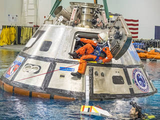 NASA astronaut Suni Williams exits a test version of the Orion spacecraft in the agency's Neutral Buoyancy Lab in Houston. The testing is helping NASA identify the best ways to efficiently get astronauts out of the spacecraft after deep space missions.. Image Credit: NASA