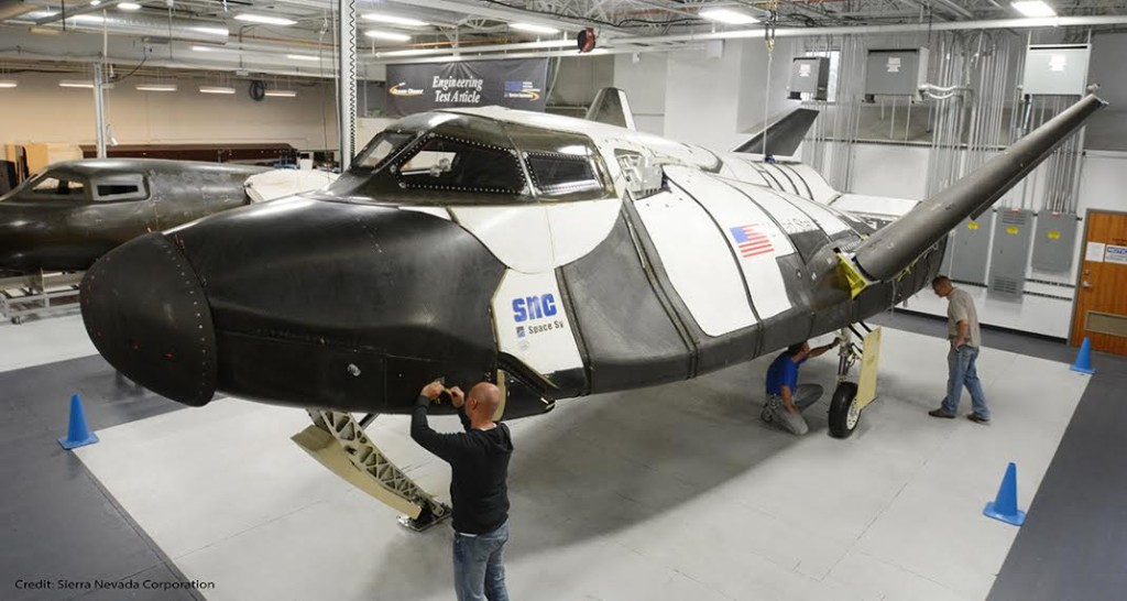 SNC technicians inspect the Dream Chaser ETA. Image Credit: Sierra Nevada Corp.