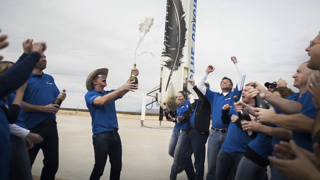 The Blue Origin team celebrates with founder Jeff Bezos at the site of the New Shepard rocket booster landing. Image Credit: Blue Origin