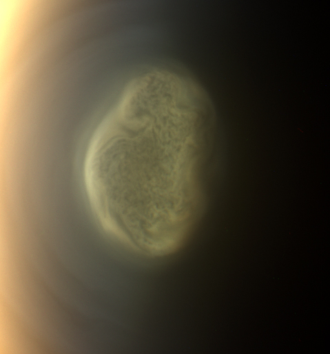 This 2012 close-up offers an early snapshot of the changes taking place at Titan's south pole. Cassini's camera spotted this impressive cloud hovering at an altitude of about 186 miles (300 kilometers). Cassini's thermal infrared instrument has now detected a massive ice cloud below it. Image Credit: NASA/JPL-Caltech/Space Science Institute