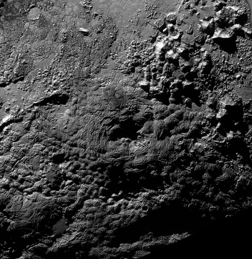 The informally named feature Wright Mons, located south of Sputnik Planum on Pluto, is an unusual feature that's about 100 miles (160 kilometers) wide and 13,000 feet (4 kilometers) high. It displays a summit depression (visible in the center of the image) that's approximately 35 miles (56 kilometers) across, with a distinctive hummocky texture on its sides. The rim of the summit depression also shows concentric fracturing. New Horizons scientists believe that this mountain and another, Piccard Mons, could have been formed by the 'cryovolcanic' eruption of ices from beneath Pluto's surface.  Image Credit: NASA/JHUAPL/SwRI