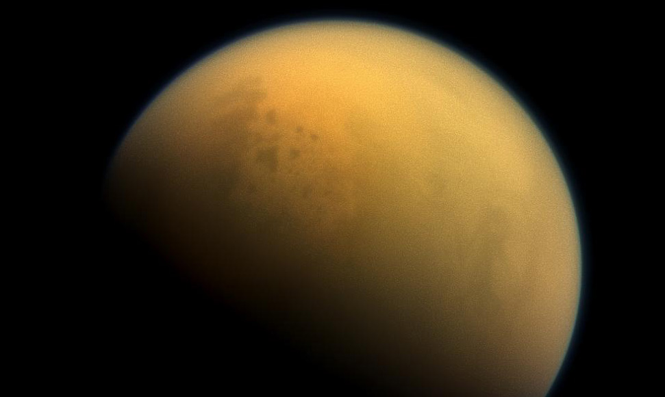 An image of Saturn's haze-shrouded moon Titan taken by the Cassini spacecraft. The UW-based Virtual Planetary Laboratory studied records of the haze on early Earth to see how such atmospheric conditions might affect an exoplanet, or one beyond our solar system. They found that such a haze might show the world is habitable, or that life itself is present. Image Credit: NASA