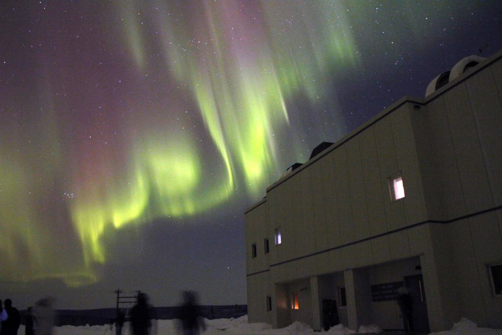An aurora as seen over the Poker Flat Research Range north of Fairbanks, Alaska, on February 28, 2011. An aurora is caused when charged particles from the Sun, mainly electrons and protons, interact with the upper atmosphere. Image Credit: NOAA