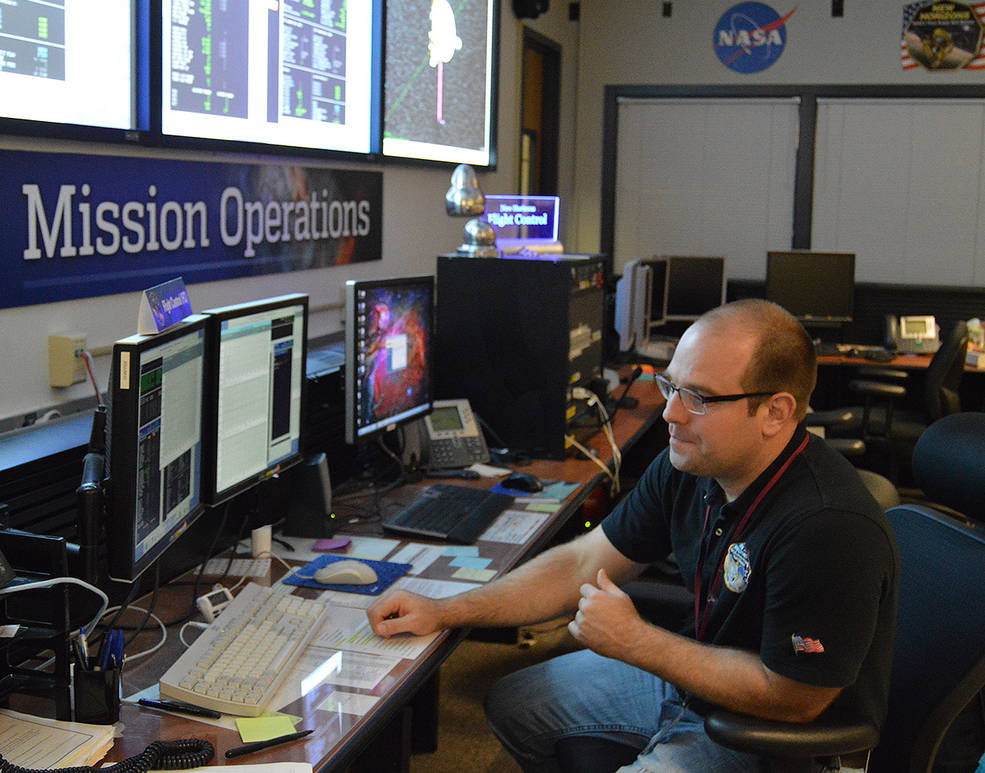 Getting the data: Following the last in a series of four maneuvers targeting NASA's New Horizons spacecraft toward Kuiper Belt object 2014 MU69, flight controller George Lawrence monitors spacecraft data as it streams into the New Horizons Mission Operations Center at the Johns Hopkins University Applied Physics Laboratory on Nov. 4, 2015. Image Credit: NASA/JHUAPL/SwRI