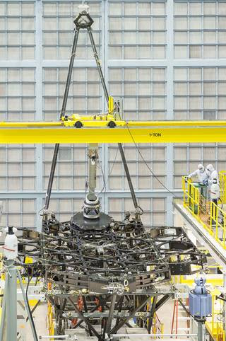 The James Webb Space Telescope team successfully installed the first flight mirror onto the telescope structure at NASA's Goddard Space Flight Center in Greenbelt, Maryland. Image Credit: NASA/Chris Gunn