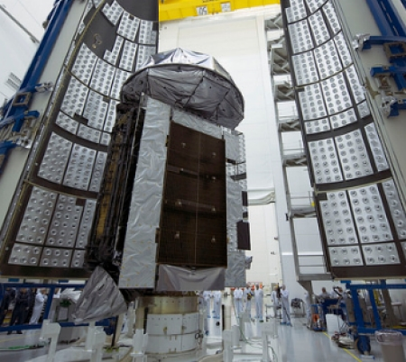 The MUOS-4 satellite, pictured above being encapsulated for its Sept. 2 launch, completes the Navy's initial Mobile User Objective System (MUOS) secure communications constellation. MUOS-5, an on-orbit spare, will launch in 2016. Image Credit: United Launch Alliance