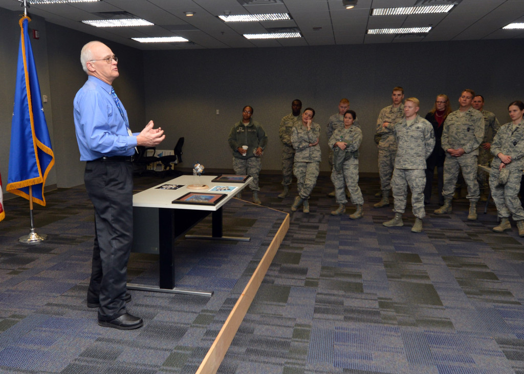 Marc Drake, Boeing satellite vehicle operations manager for 2nd Space Operations Squadron, speaks to members of Team Black Jack about the life of satellite vehicle number 23 during a ceremony celebrating the satellite's 25th anniversary in Building 400 at Schriever Air Force Base, Colorado, Wednesday, Dec. 2, 2015. SVN-23 is currently the oldest satellite in the Global Positioning System's orbit. Image Credit: U.S. Air Force/Staff Sgt. Debbie Lockhart