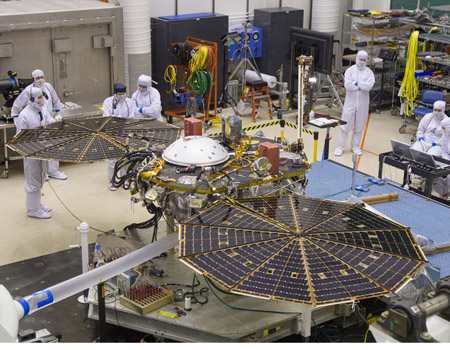 Prior to delivery of NASA's InSight Mars lander, the lander underwent a final solar array deployment test in a clean room at Lockheed Martin. Image Credit: Lockheed Martin