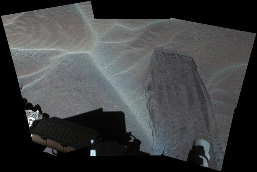 A wheel track left by NASA's Curiosity Mars rover exposes underlying material in a shallow sand sheet in this Dec. 2, 2015, view from Curiosity's Mast Camera (Mastcam). Image Credit: NASA/JPL-Caltech/MSSS