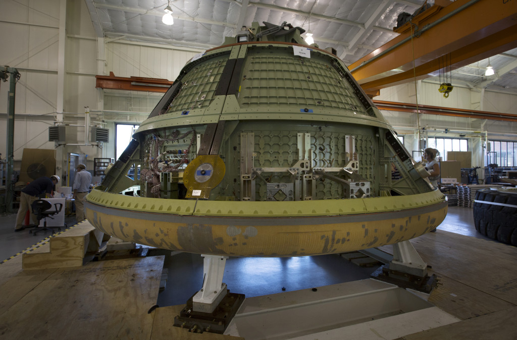 Engineers at NASA's Langley Research Center in Hampton, Virginia, coupled a NASA Orion crew module mockup with the heat shield from the spacecraft's first flight test, Exploration Flight Test 1 (EFT-1) . The integrated Orion mockup and EFT-1 heat shield will be tested next year to simulate water landings during actual missions. Image Credit: NASA/David C. Bowman