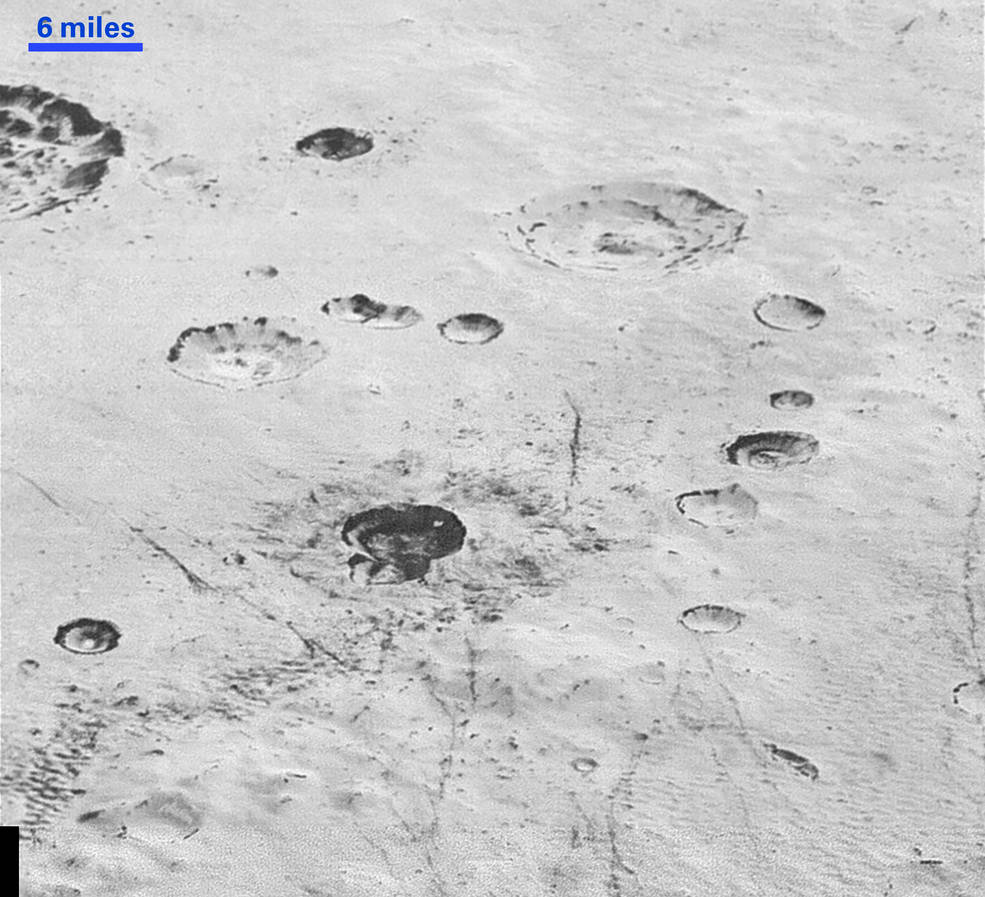"Layered Craters and Icy Plains: This highest-resolution image from NASA's New Horizons spacecraft reveals new details of Pluto's rugged, icy cratered plains, including layering in the interior walls of many craters. ""Impact craters are nature's drill rigs, and the new, highest-resolution pictures of the bigger craters seem to show that Pluto's icy crust, at least in places, is distinctly layered,"" said William McKinnon, deputy lead of the New Horizons Geology, Geophysics and Imaging team, from Washington University in St. Louis. ""Looking into Pluto's depths is looking back into geologic time, which will help us piece together Pluto's geological history."" Image Credit: NASA/JHUAPL/SwRI"