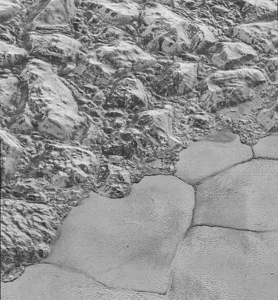 "The Mountainous Shoreline of Sputnik Planum: In this highest-resolution image from NASA's New Horizons spacecraft, great blocks of Pluto's water-ice crust appear jammed together in the informally named al-Idrisi mountains. ""The mountains bordering Sputnik Planum are absolutely stunning at this resolution,"" said New Horizons science team member John Spencer of the Southwest Research Institute. ""The new details revealed here, particularly the crumpled ridges in the rubbly material surrounding several of the mountains, reinforce our earlier impression that the mountains are huge ice blocks that have been jostled and tumbled and somehow transported to their present locations."" Image Credit: NASA/JHUAPL/SwRI"