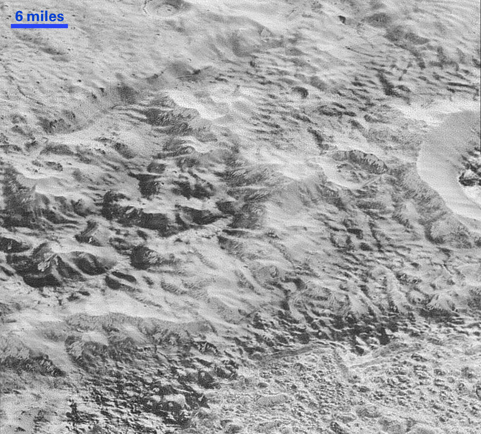 Pluto's 'Badlands': This highest-resolution image from NASA's New Horizons spacecraft shows how erosion and faulting have sculpted this portion of Pluto's icy crust into rugged badlands topography. Image Credit: NASA/JHUAPL/SwRI