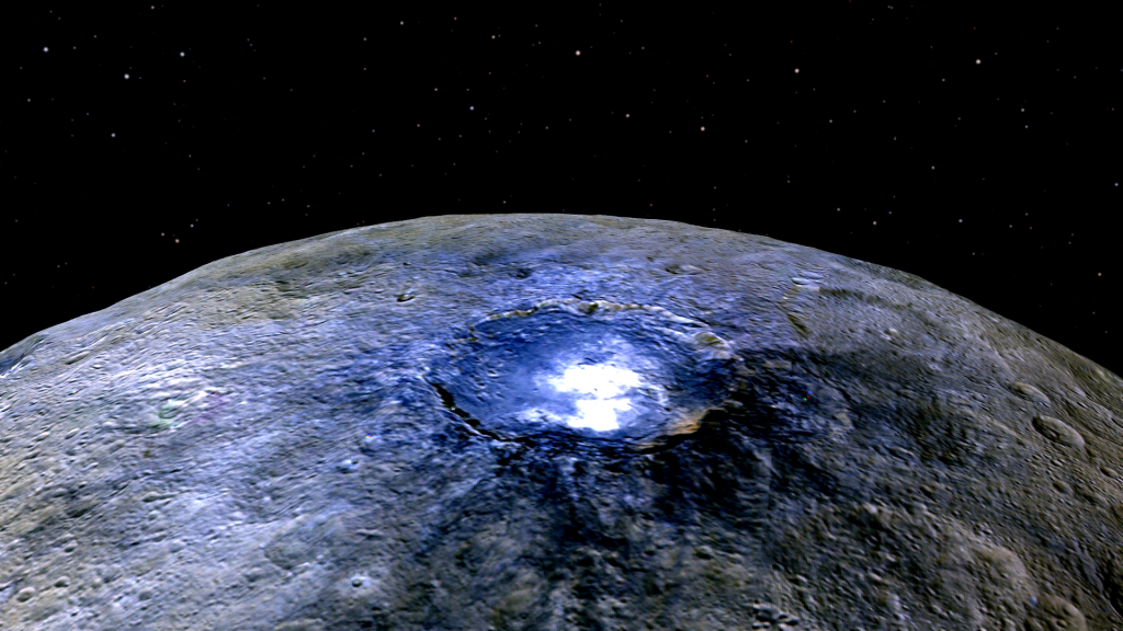 This representation of Ceres' Occator Crater in false colors shows differences in the surface composition. Image Credit: NASA/JPL-Caltech/UCLA/MPS/DLR/IDA