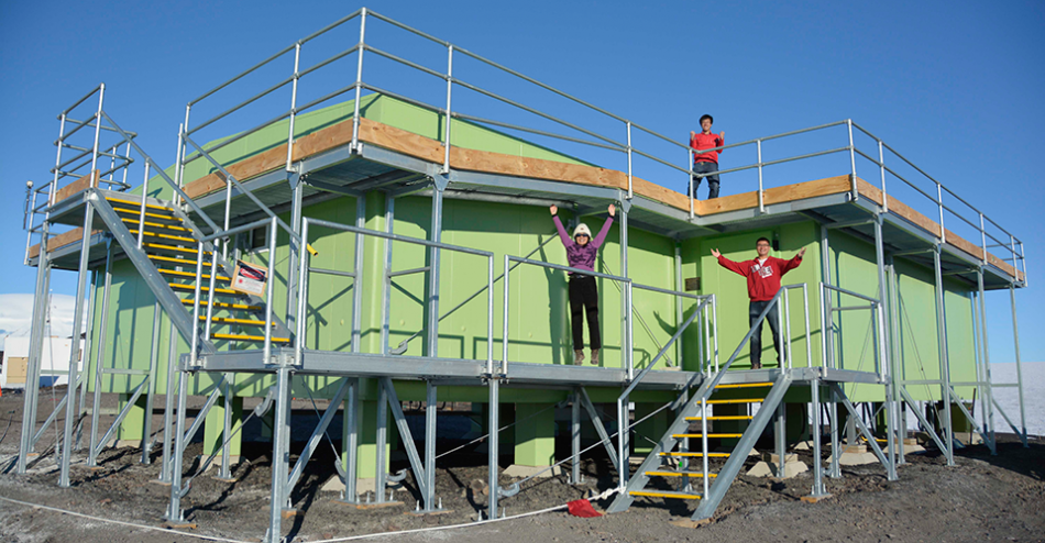 Xinzhao Chu, Jian Zhao and Cao Chen celebrate outside the Antarctica New Zealand building at Arrival Heights, Antarctica,  following a season of extensive lidar observations of the high atmosphere. Image Credit: CIRES and CU-Boulder