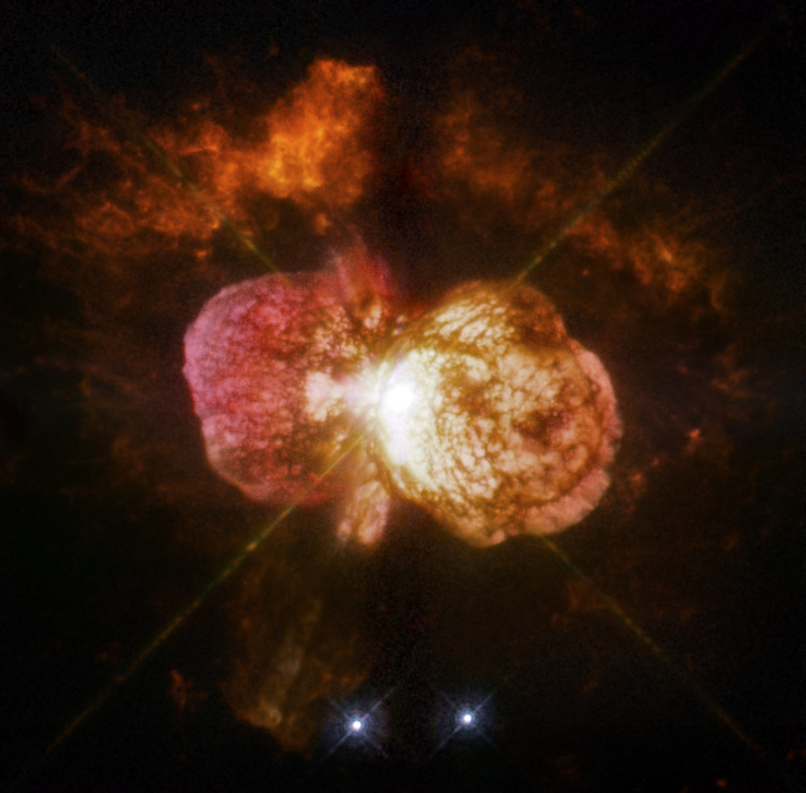 Eta Carinae's great eruption in the 1840s created the billowing Homunculus Nebula, imaged here by Hubble, and transformed the binary into a unique object in our galaxy. Astronomers cannot yet explain what caused this eruption. The discovery of likely Eta Carinae twins in other galaxies will help scientists better understand this brief phase in the life of a massive star. Image Credit: NASA, ESA, and the Hubble SM4 ERO Team