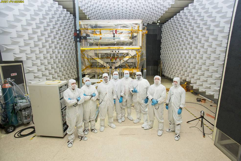 A team of engineers in special clean room suits at NASA Goddard. Seen from left to right: Andy Mentges, Nathan Block, Vaughn Nelson, Rob Houle, John McCloskey, Mark Branch, Rick Jones, Greg Jamroz. Image Credit: NASA/Chris Gunn