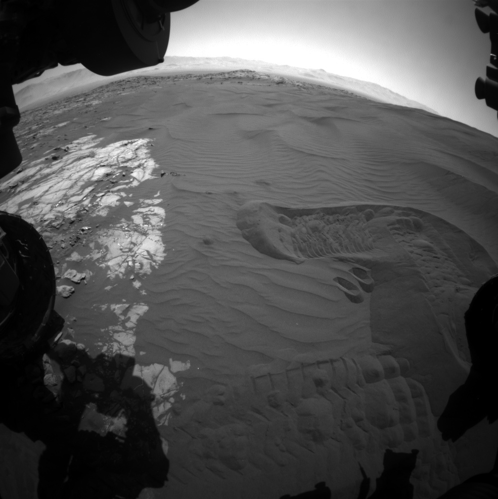 This view captures Curiosity's current work area where the rover continues its campaign to study an active sand dune on Mars. This site is part of the Bagnold Dunes, a band of dark sand dunes along the northwestern flank of Mars' Mount Sharp. This image was taken on Jan. 20, 2016, during the 1,229th Martian day, or sol, by Curiosity's front hazardous avoidance camera. Image Credit: NASA/JPL-Caltech