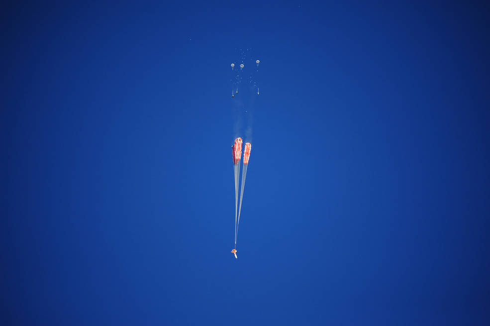 Orion's three main parachutes begin to unfurl after they are drawn out by three pilot parachutes. A test of the spacecraft's parachute system was conducted Jan. 13. Image Credit: NASA