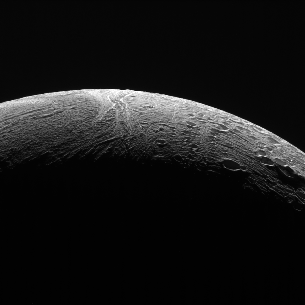 NASA's Cassini spacecraft peered out over the northern territory on Saturn's moon Enceladus, capturing this view of two different terrain types. A region of older terrain covered in craters that have been modified by geological processes is seen at right, while at left is a province of relatively craterless, and presumably more youthful, wrinkled terrain. Cassini acquired the view during its final close flyby of Enceladus, on Dec. 19, 2015. Image Credit: NASA/JPL-Caltech/Space Science Institute