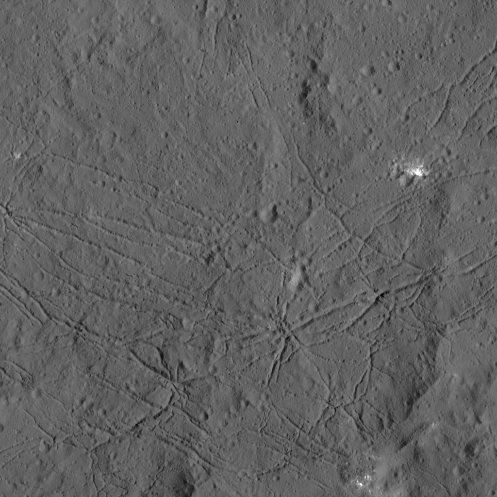 The fractured floor of Dantu Crater on Ceres is seen in this image from NASA's Dawn spacecraft. Similar fractures are seen in Tycho, one of the youngest large craters on Earth's moon. This cracking may have resulted from the cooling of impact melt, or when the crater floor was uplifted after the crater formed. Image Credit: NASA/JPL-Caltech/UCLA/MPS/DLR/IDA