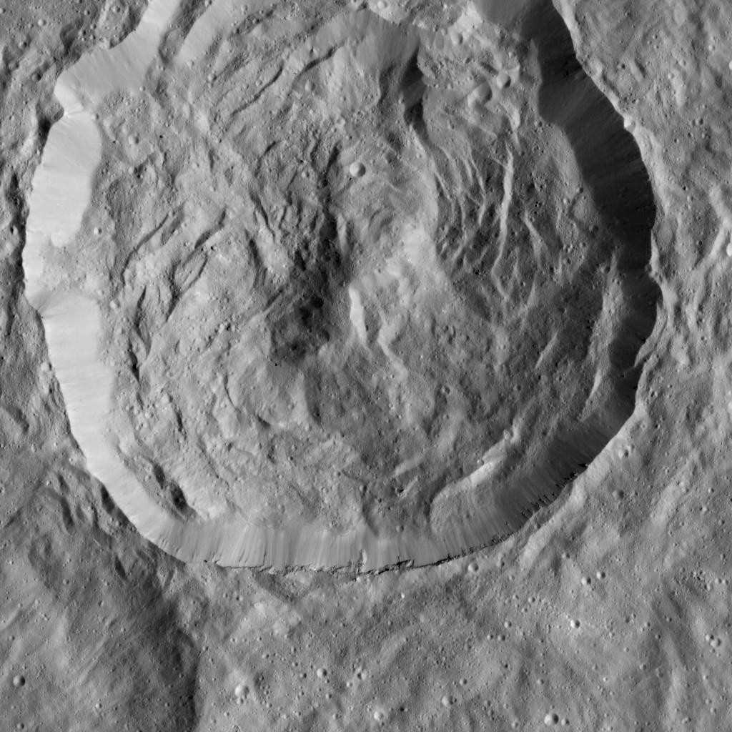 NASA's Dawn spacecraft viewed this Cerean crater, which is covered in ridges and steep slopes, called scarps on Dec. 23, 2015. These features likely resulted when the crater partly collapsed during its formation. The curvilinear nature of the scarps resembles those on the floor of Rheasilvia, the giant impact crater on Vesta, which Dawn orbited from 2011 to 2012. Image Credit: NASA/JPL-Caltech/UCLA/MPS/DLR/IDA