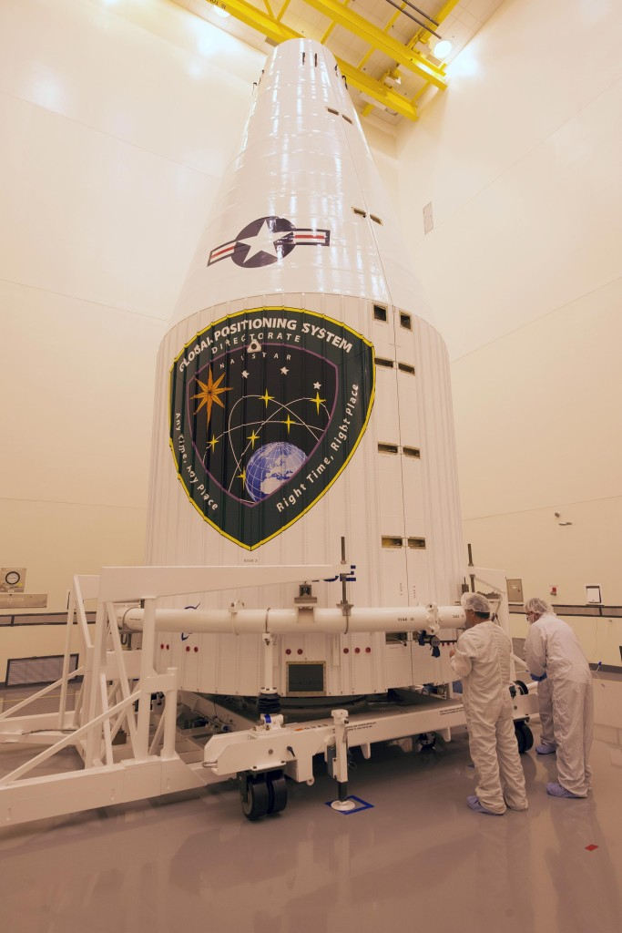 The Air Force's 12th GPS IIF satellite is encapsulated inside an Atlas V 4-meter payload fairing before being transported to a United Launch Alliance facility for hoist and mate at Cape Canaveral Air Force Station, Florida. Image Credit: United Launch Alliance