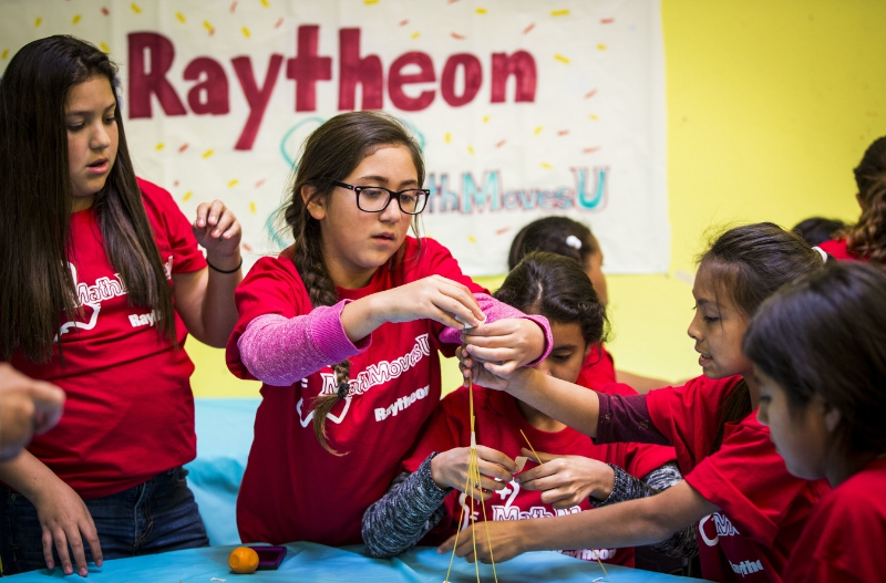 A team of girls builds a structure with spaghetti at the Los Angeles Harbor Boys & Girls Club. The activity was an exercise in civil engineering, and it was part of Raytheon's program for Girl Day 2015, a National Engineers Week event that encourages girls to discover the field and study science, technology, engineering and math. Image Credit: PRNewsFoto/Raytheon Company