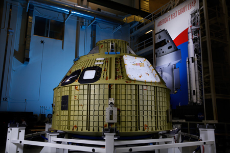 The Orion spacecraft's crew module has been safely secured into its structural assembly tool in the Operations & Checkout Facility. Image Credit: Lockheed Martin