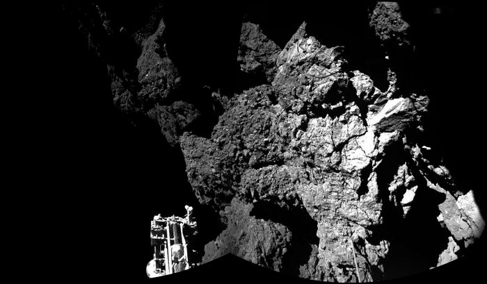 Rosetta's lander Philae is safely on the surface of Comet 67P/Churyumov-Gerasimenko, as these first two CIVA images confirm. One of the lander's three feet can be seen in the foreground. The image is a two-image mosaic. Image Credit: ESA/Rosetta/Philae/CIVA