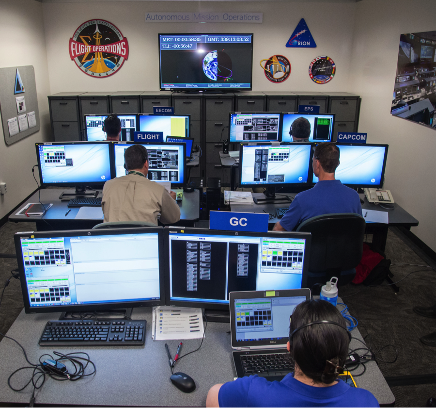 Flight controllers took part in a joint simulation with astronauts to evaluate the prototype Orion crew display and control system, advanced caution and warning system for flight controllers and communication protocols. Image Credit: NASA