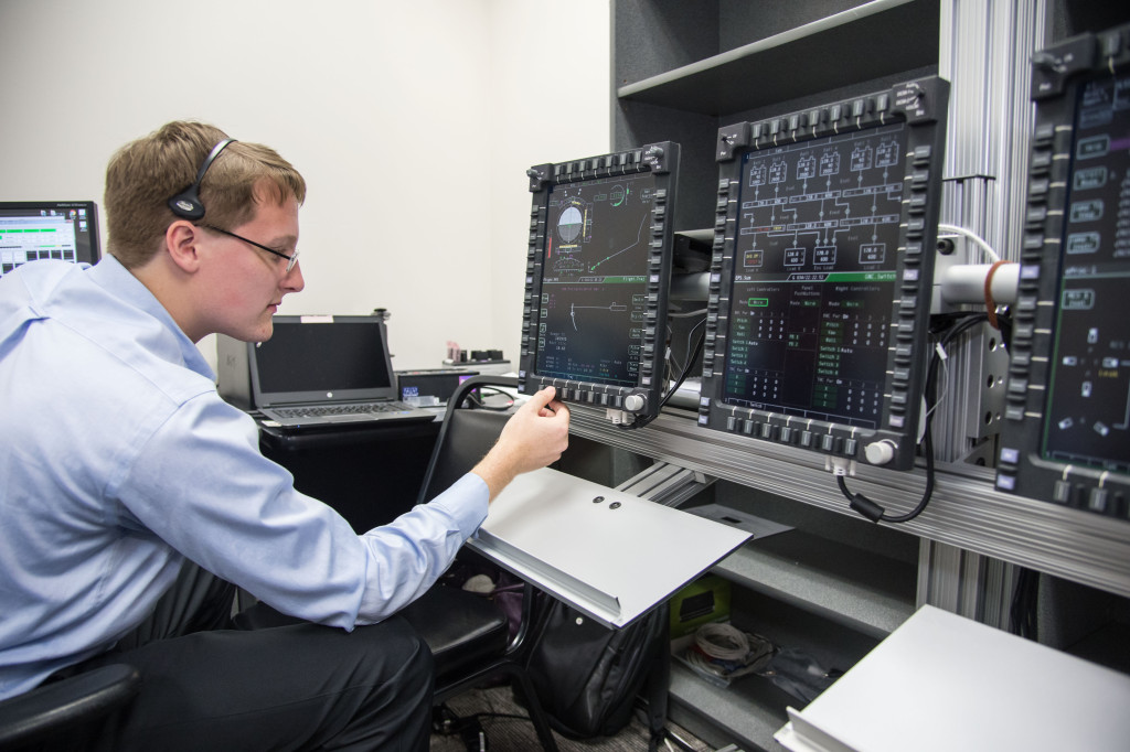 An engineer evaluates Orion's display and control system. Image Credit: NASA/Lauren Harnett