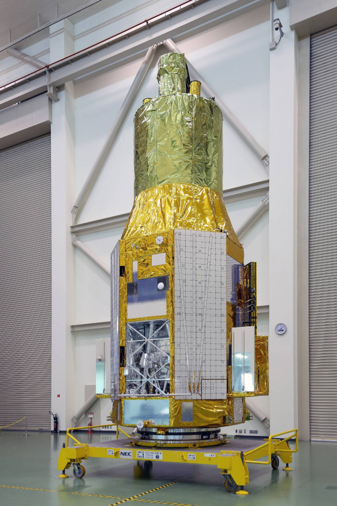 The ASTRO-H spacecraft as it appeared on Nov. 27, 2015, at Tsukuba Space Center in Japan. The open compartment visible at lower left houses the Soft X-ray Spectrometer. Image Credit: JAXA
