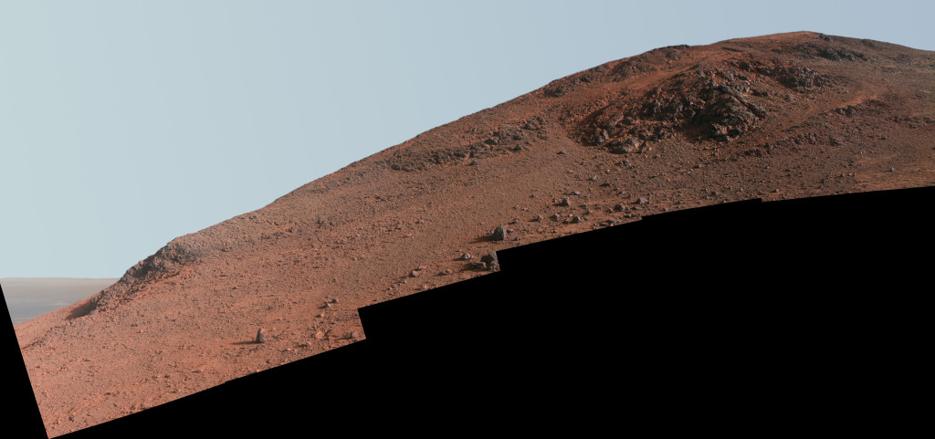 "This scene from NASA's Mars Exploration Rover Opportunity looks upward at ""Knudsen Ridge"" from the valley below. Enhanced color makes ""red zone"" material on the ridge easier to recognize. Image Credit: NASA/JPL-Caltech/Cornell Univ./Arizona State Univ."