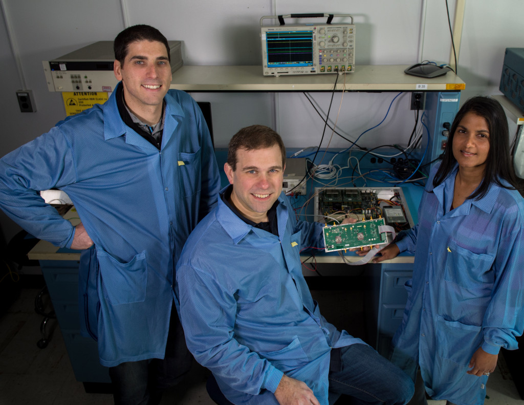Jared Lucey, Jeffrey Piepmeier, and Priscilla Mohammed, a research engineer at Morgan State University, are developing a new CubeSat mission to test RFI-mitigation strategies. They are shown here with a testbed for testing mitigation algorithms. Image Credit: NASA/Bill Hrybyk