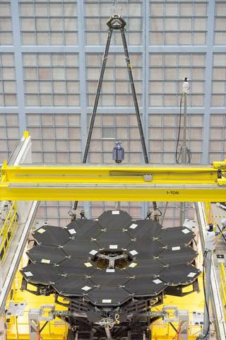 In this rare view, the James Webb Space Telescope's 18 mirrors are seen fully installed on the James Webb Space Telescope structure at NASA's Goddard Space Flight Center in Greenbelt, Maryland. Image Credit: NASA/Chris Gunn